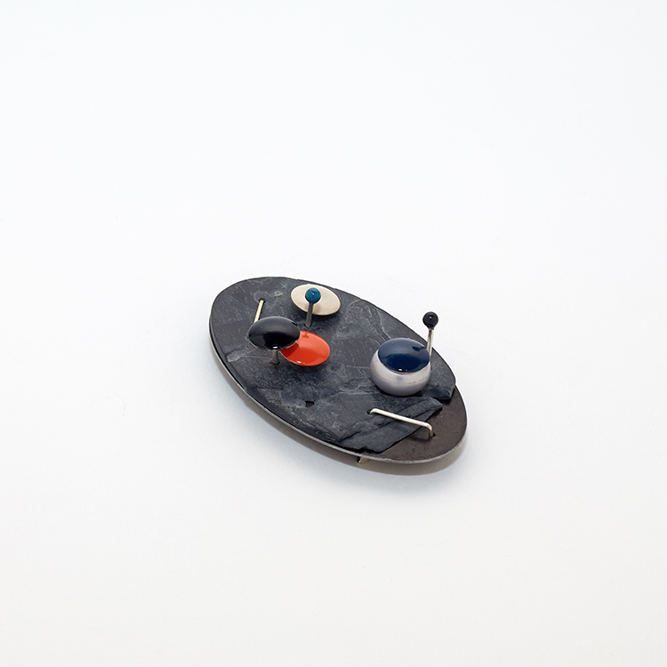 Holly O'Hanlon, Excess 02#19, brooch, mild steel, slate, 925 silver, dyed button pearl, enamel, linseed oil, renaissance wax, two-part epoxy, steel pin, 64 x 36 x 20 mm - photo: Holly Whittaker